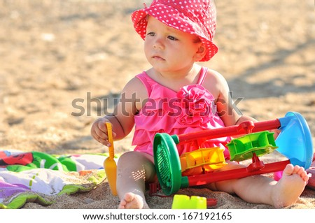 cute baby girl playing  on the beach