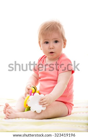Cute baby girl playing with toys isolated on white background - stock photo