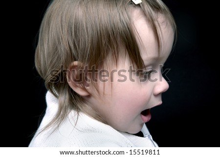 Cute baby girl profile, isolated on black - stock photo