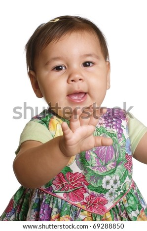 Cute baby girl smiling, hand raised, one year old, isolated on white background - stock photo