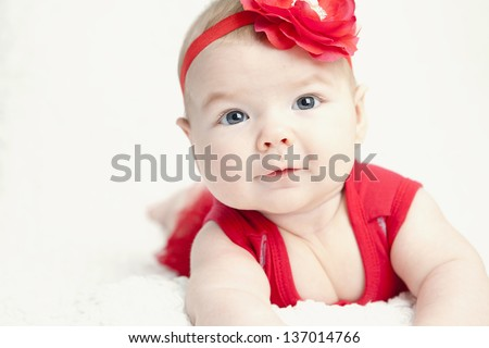 cute baby girl wearing red