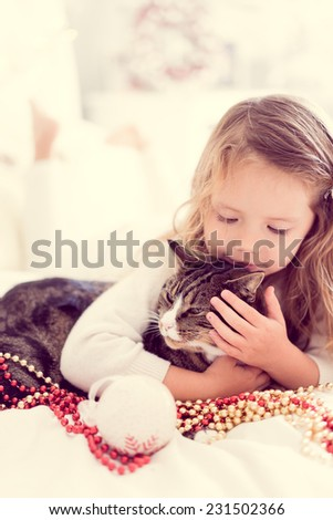 Cute baby girl with her cat - stock photo