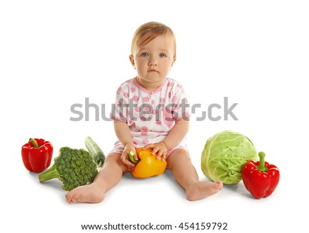 Cute baby girl with vegetables, isolated on white - stock photo
