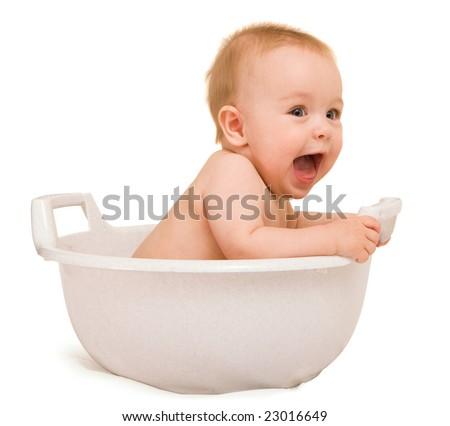 Cute baby having bath in white tub - stock photo