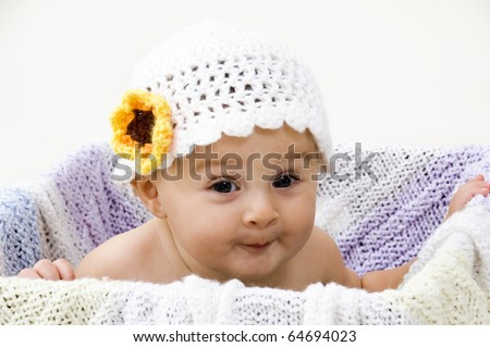 Cute Baby in Crochet Hat with Expressive Face. - stock photo