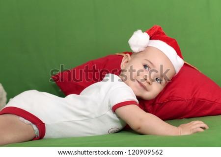 Cute baby in Santa Hat - stock photo