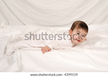 cute baby in stretch and grow - stock photo