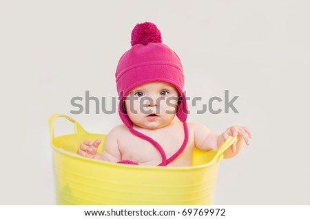 Cute baby in the tub - stock photo
