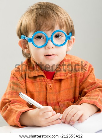 Cute baby learning and getting ready for school in kindergarden - stock photo