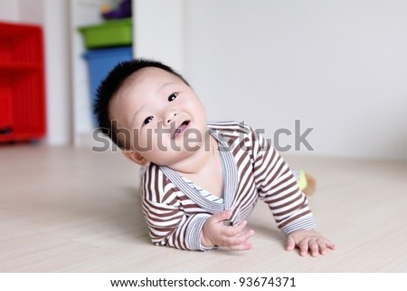 Cute Baby Look Up forward with home background, Baby is a cute asian child - stock photo