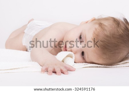 Cute baby lying on a white blanket