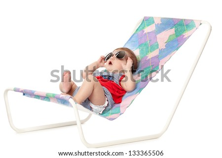 cute baby lying on lounger isolated on white - stock photo