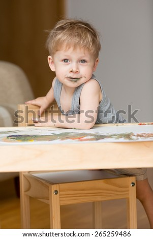 Cute baby painting. - stock photo
