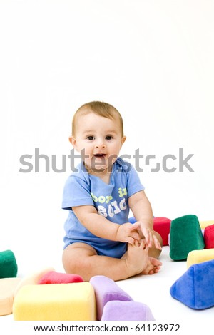 Cute Baby Playing with Plush Blocks - stock photo