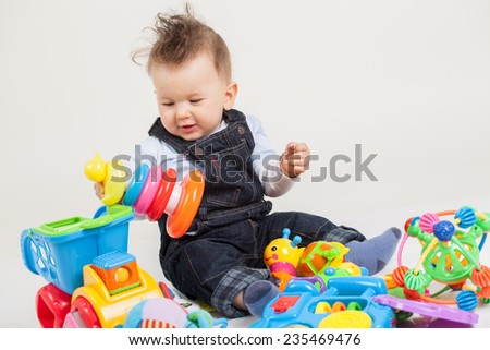 cute baby playing with toys  - stock photo
