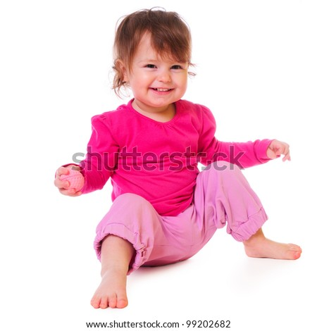 cute baby sitting and smiling. pink clothing. isolated on white - stock photo