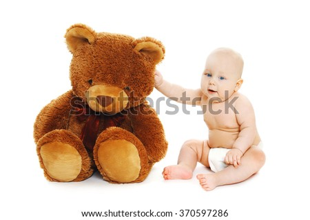 Cute baby sitting with big teddy bear on white background - stock photo