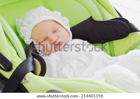 cute baby sleeping in a car seat. - stock photo
