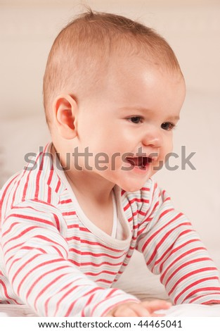 Cute baby smiling showing his first two teeth - stock photo