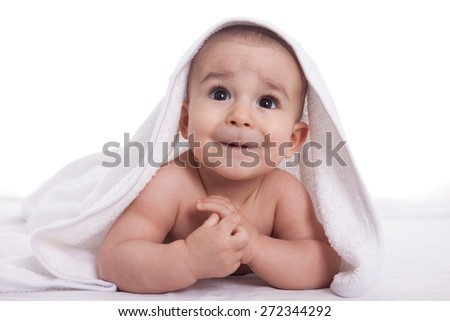 Cute baby with big beautiful eyes after shower isolated on white - stock photo