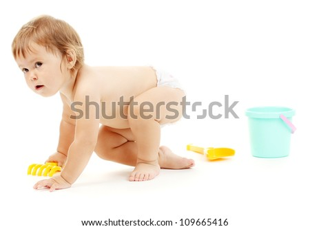 Cute baby with bucket and spade isolated on white