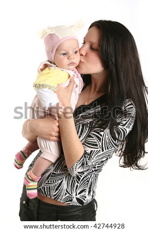 Cute baby with mother - stock photo