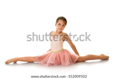 Cute ballerina child of school age, doing the splits-Isolated on white background - stock photo