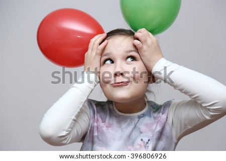 Cute beautiful girl celebrate her birthday. happy girl with balls - stock photo
