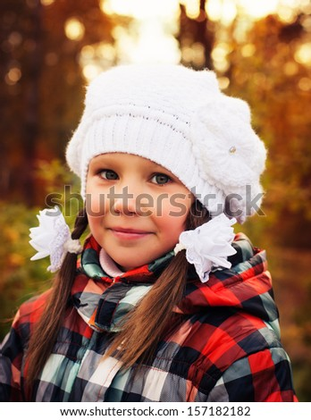 Cute beautiful girl in the autumn park.