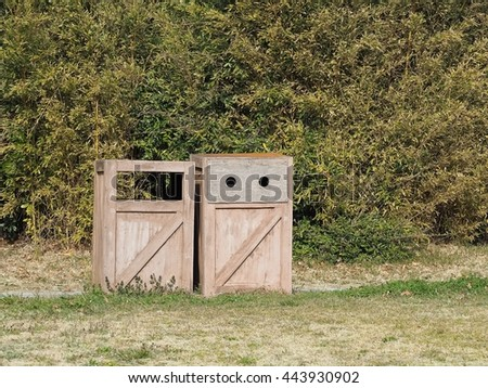 Cute bin in a garden.Outdoor Dustbin.Wood Dustbins.Wooden Rubblish Bin. - stock photo