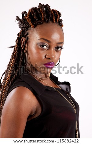 Cute black woman   looking into the camera with a serious expression - stock photo