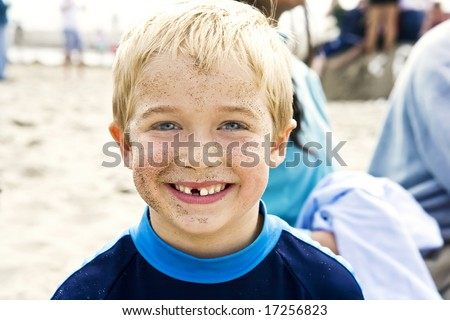 Cute blond child with a big toothless - stock photo