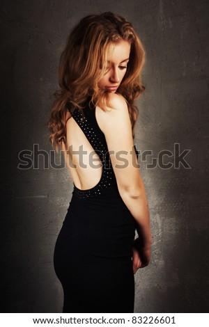 cute blond girl in a beautiful black dress - stock photo