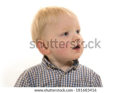 Cute blond haired 2-year-old baby boy in dress clothes on white background