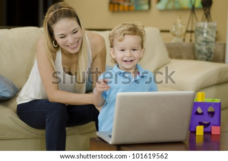 Cute blond kid playing and having fun with her mom