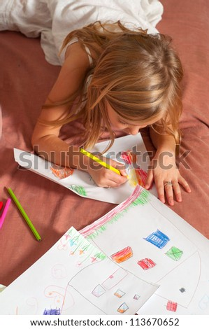 Cute blond little girl drawing on the paper. - stock photo
