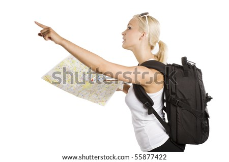 cute blond tourist girl with map and backpack point her finger at something - stock photo