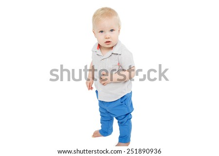 cute blonde blue eyed baby boy standing over white background - stock photo