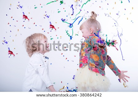 Cute blonde children playing in a white studio.  - stock photo