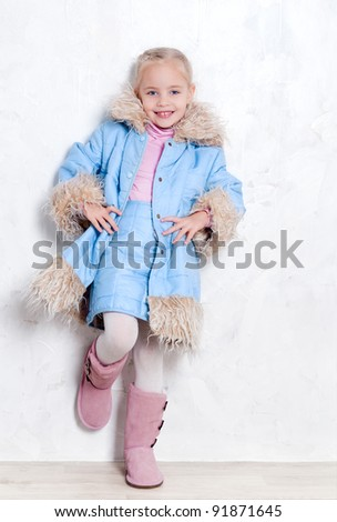 Cute blonde girl posing in fashion winter outfit - stock photo