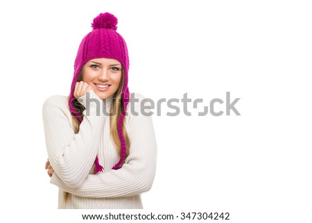 Cute blonde teenage girl in white sweater and modern magenta knitted beanie hat posing, smiling, isolated on white background. Horizontal, copy space. - stock photo