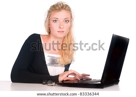 cute blonde with a laptop at the table - stock photo