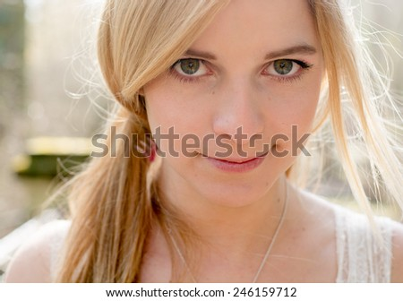 cute blonde woman outdoor - stock photo