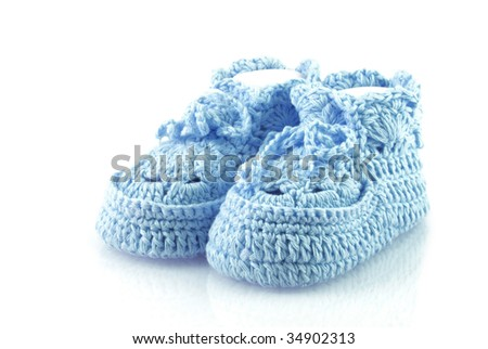 Cute blue baby footwear on a white background. - stock photo