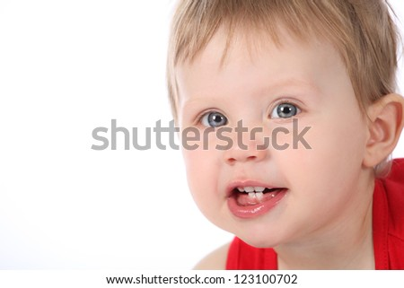 Cute blue eyed brunette baby girl pulling funny faces and wearing a pretty red dress isolated on a white background - stock photo