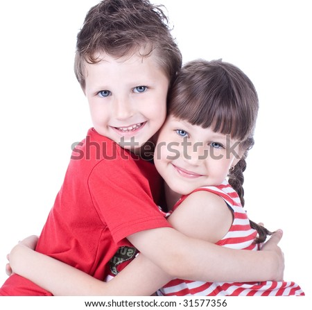 Cute blue-eyed children hug each other , studio shot