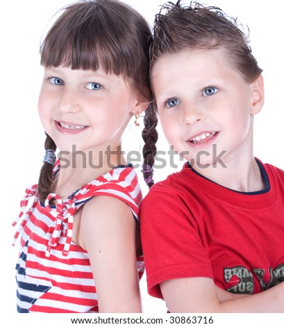 Cute blue-eyed children posing in studio - stock photo