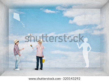 Cute boy and girl of school age painting wall with roller