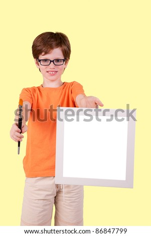 cute boy and happy with a paintbrush and a blank slate, studio shot
