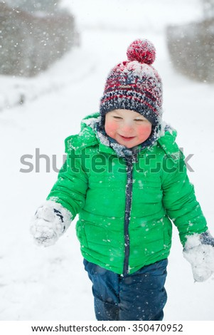 cute boy and snowfall
